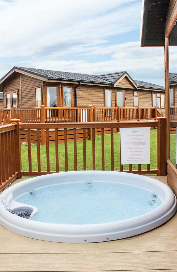 Owl 39 s nest in tattershall lakes country park this detached spacious log cabin overlooking the for Tattershall lakes swimming pool